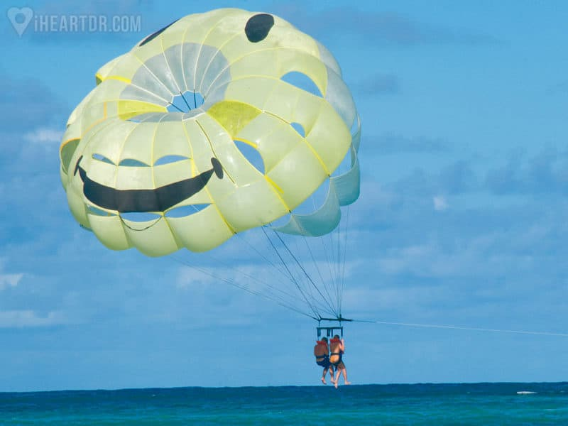 Couple flying low while parasailing