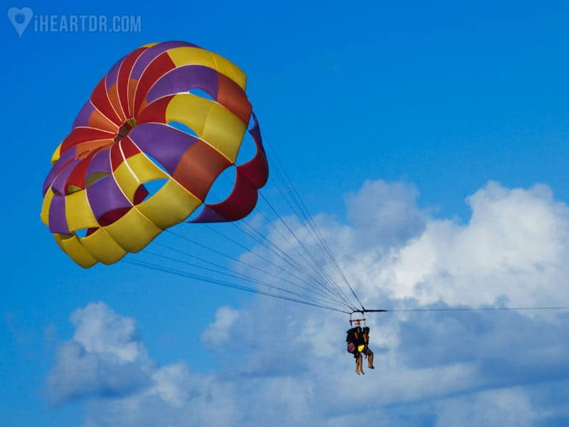 Couple flying high while parasailing