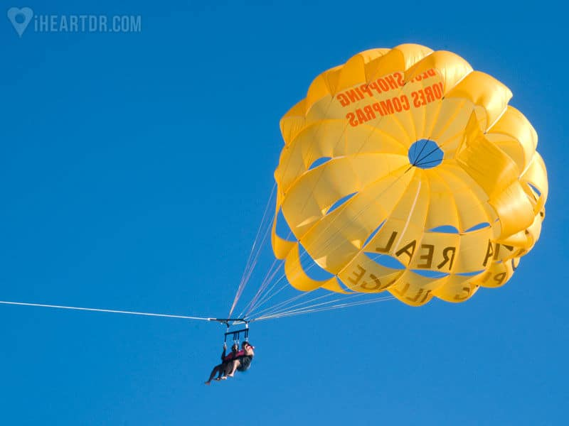 Couple seen from below while parasailing