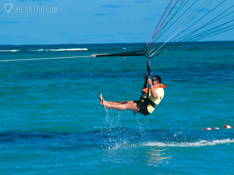 Man parasailing and getting wet