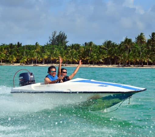 Couple driving a speedboat