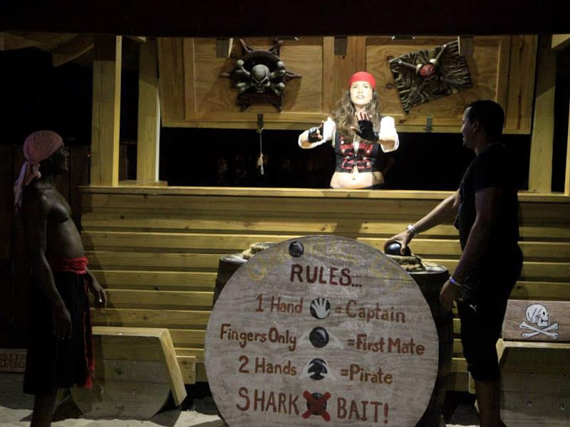Female pirate explaining some of the rules