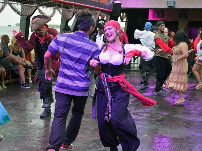 Female pirate dancing with a man from the audience