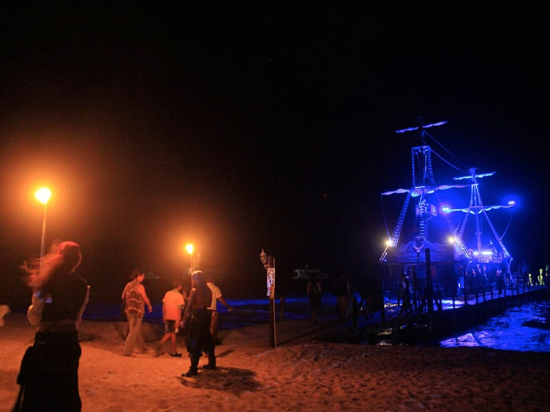 Boarding the pirate ship in the light of torches