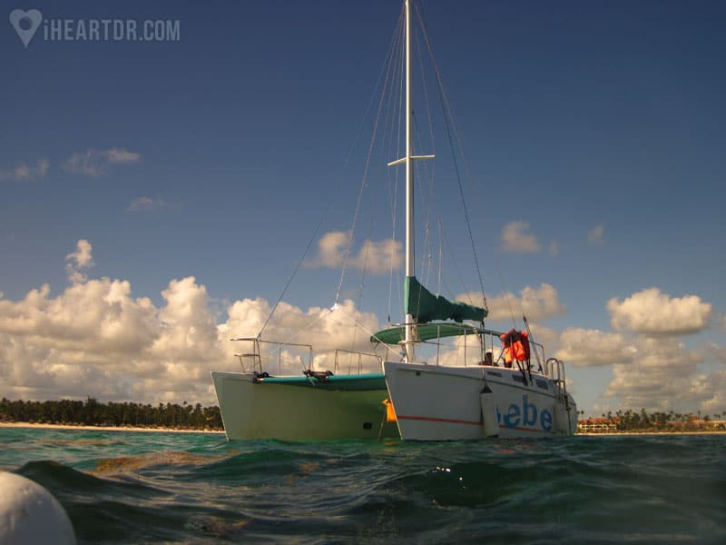 The catamaran seen from the water in the sunset