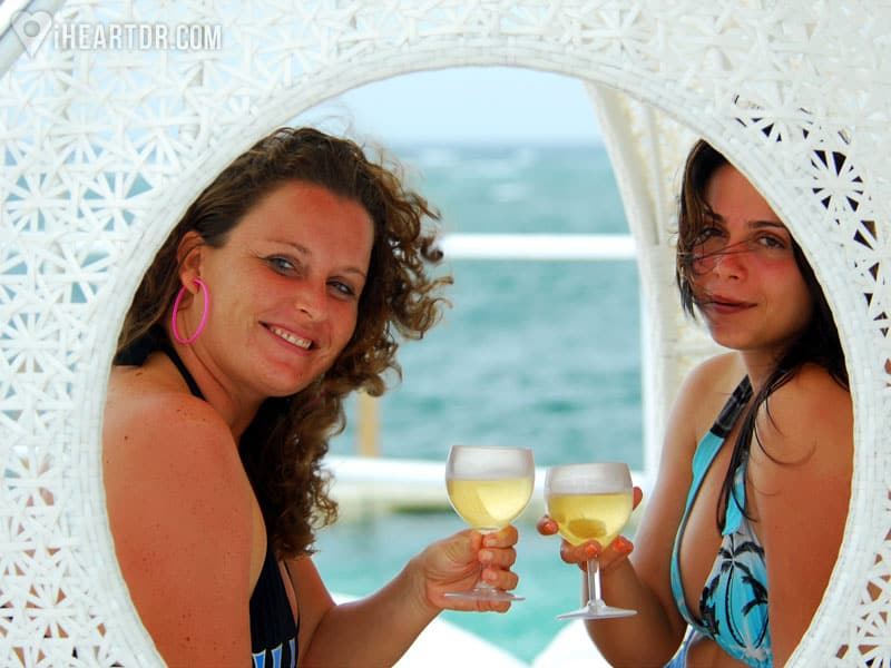 Two women toasting with white wine