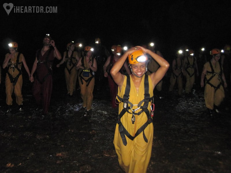 Group walking in the cave with their headlamps on