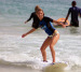 Woman surfing in Macao beach