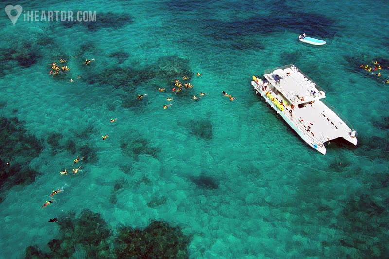 Marinarium boat and people snorkeling seen from the air