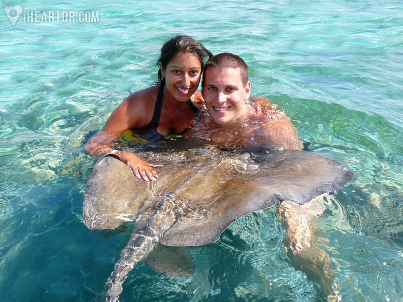 Young couple posing with a stingray