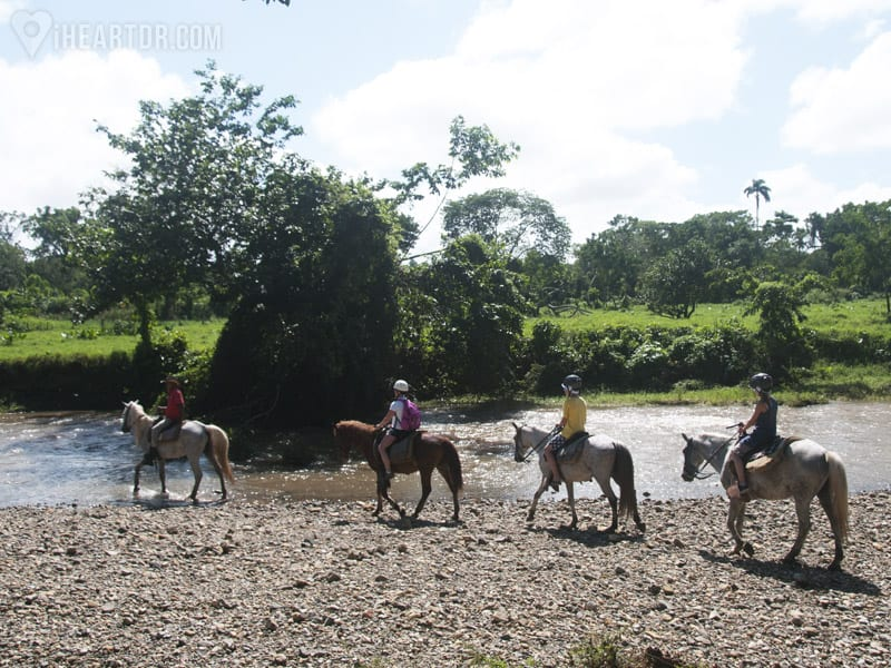 Horseback riding near a river
