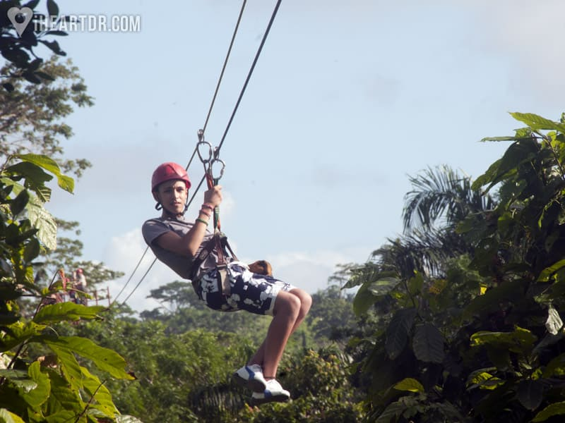 Young man zip lining