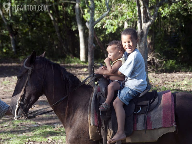 Two small local boys on a horse