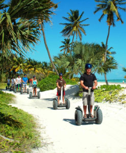 Group of people riding segways on the beach