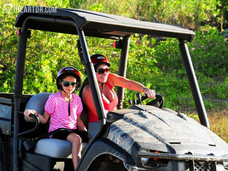 Mother and daughter drive a buggy