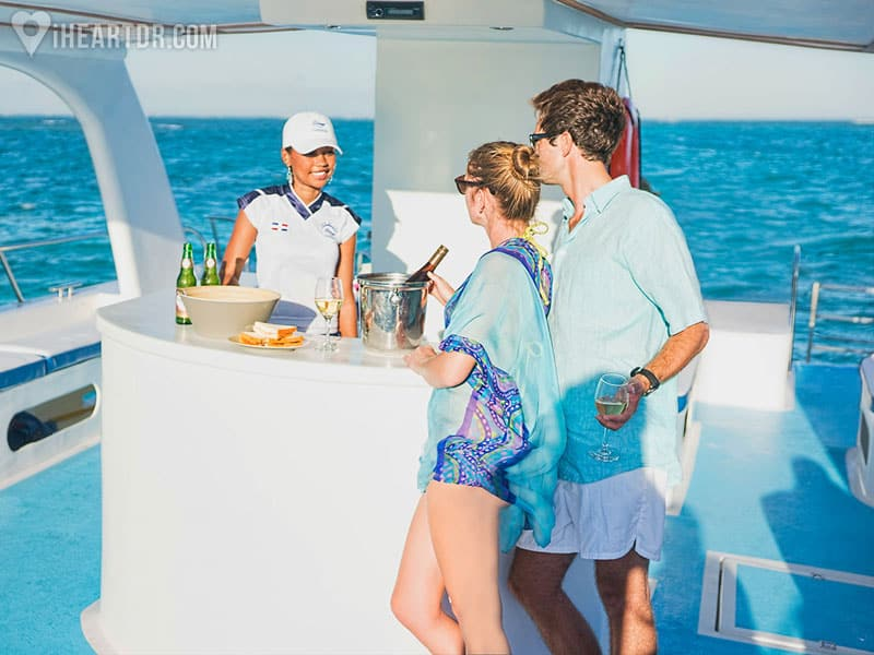 Couple in front of the bar on the catamaran