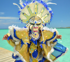 Man in traditional carnival costume with the beach as background