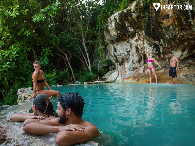 Group of people enjoying the natural waterfall in Cap Cana, Punta Cana