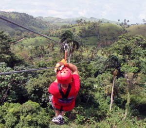 Man zip lining in the mountain