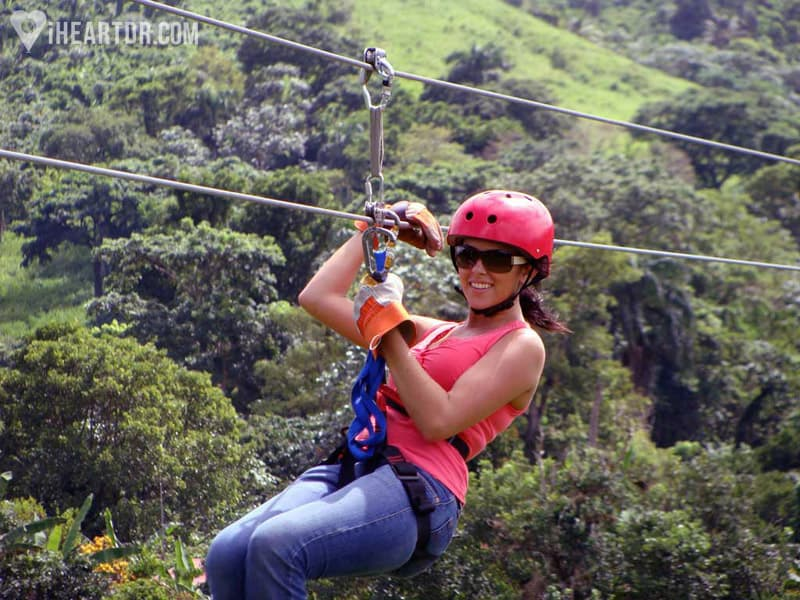 Woman zip lining about to arrive at one of the platforms