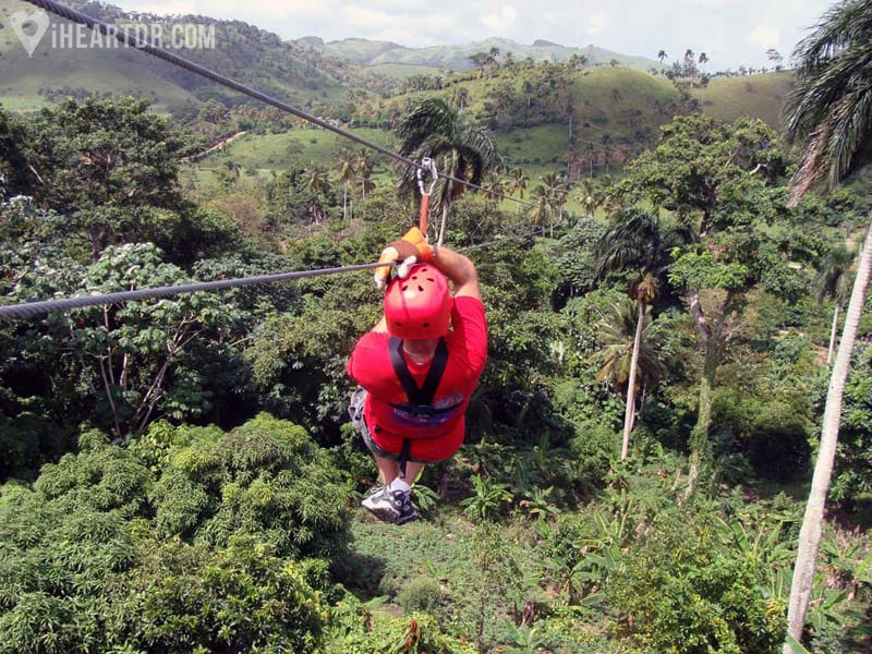 Man zip lining on one of the longest lines