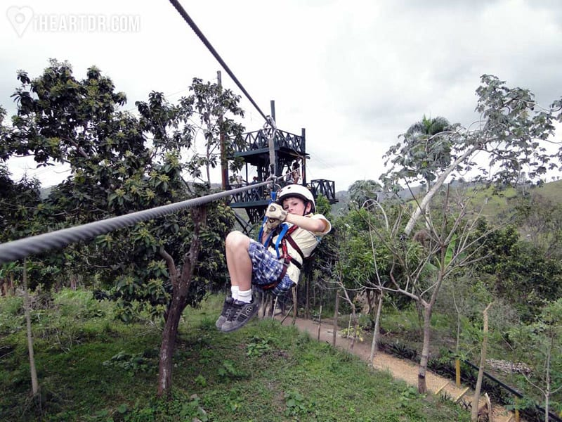 Young boy riding one of the zip lines