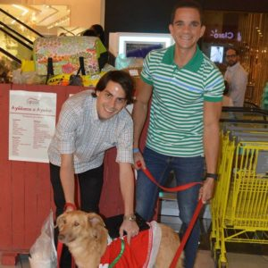 Donation to the Doggie House Foundation - Santa Claus and two cute dogs - Posing with two cute dogs