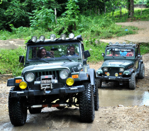 Jeeps crossing a mud puddle