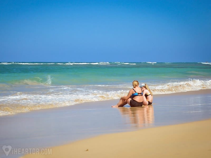 Mother and daughter sitting at the beach during the 4x4 Punta Cana Safari
