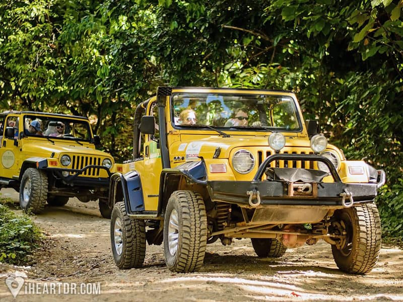Jeeps driving in the jungle during the All terrain Punta Cana Jeep tour