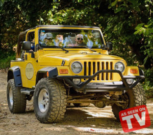 Yellow 4x4 Wrangler jeep driving during the Punta Cana Jeep Safari tour