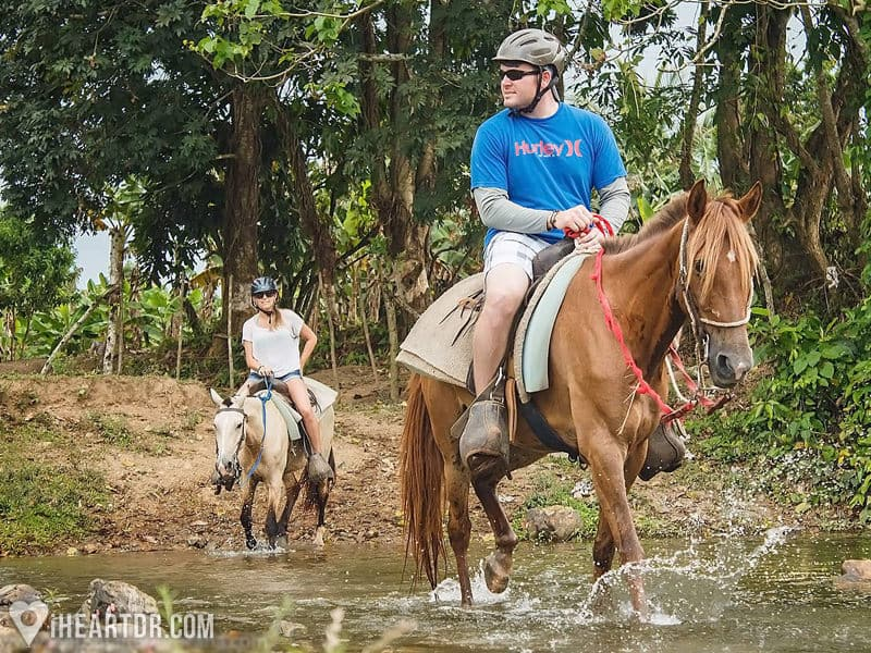 Crossing a river while horseback riding during the Punta Cana Safari by Jeep