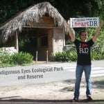 Me holding an I heart DR sign in front of the park's entrance