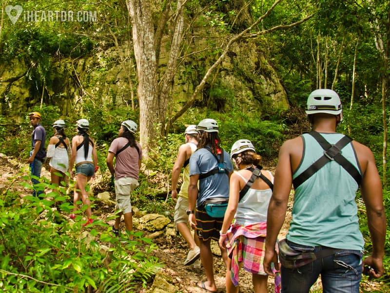 Group walking to the cave through an eco trail