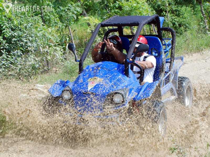 Blue buggy splashing mud