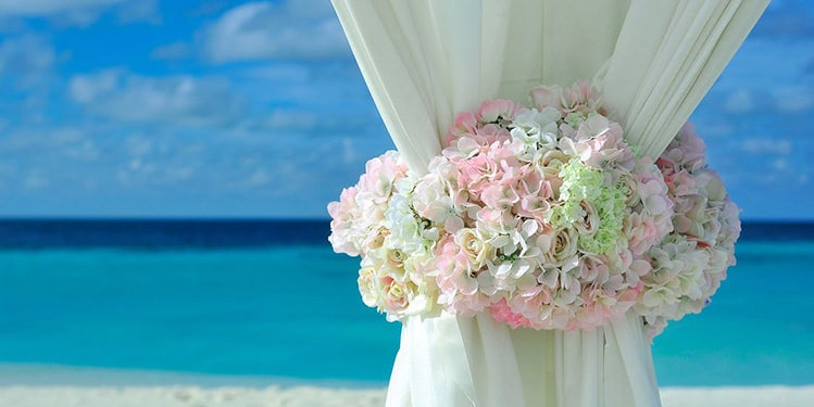 Bouquet of flower by the beach, symbolizing a Punta Cana wedding.