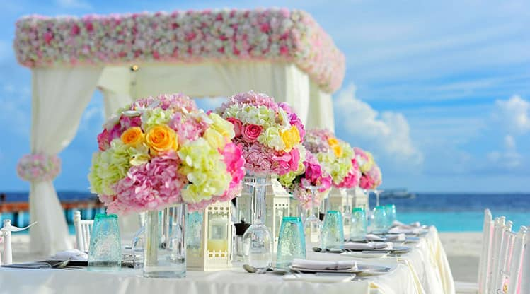 Wedding reception table set at the beach