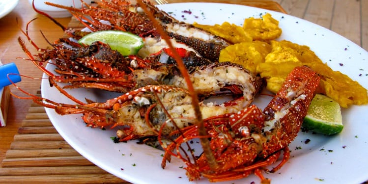Plate Of Food With Lobster And Fried Green Plantain