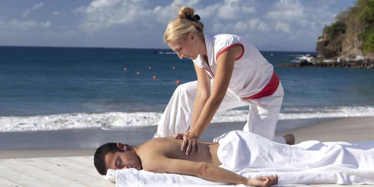 Man receiving a massage on the beach