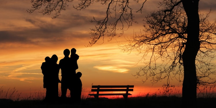Family silhouettes at sunset