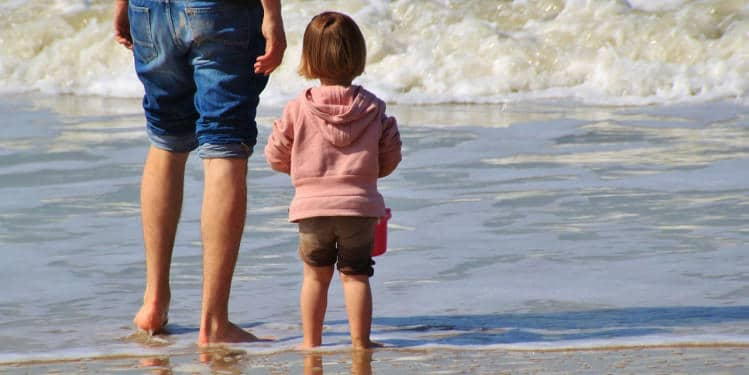 Girl with her father in the beach